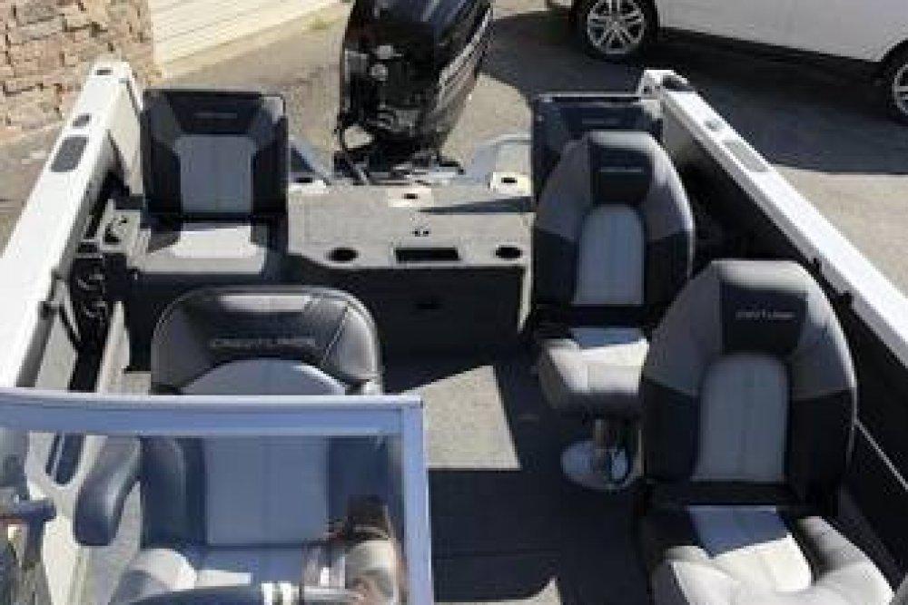 Grey and white boat interior with 4 seats