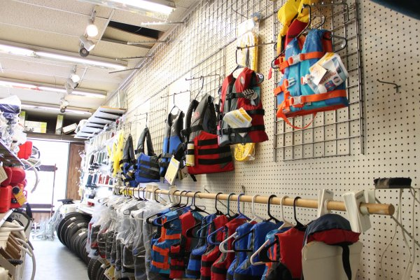 Selection of life jackets in store aisle